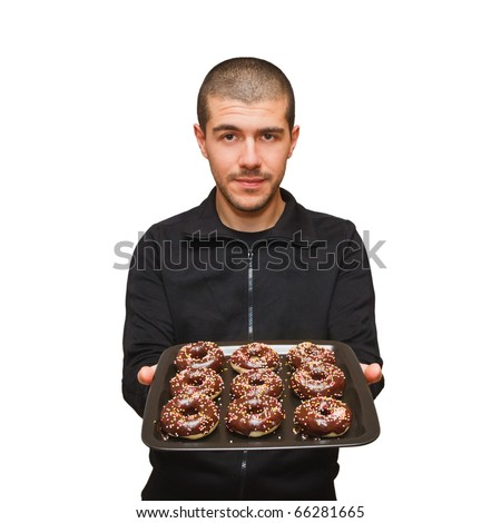 Man offers a tray of sprinkled doughnuts
