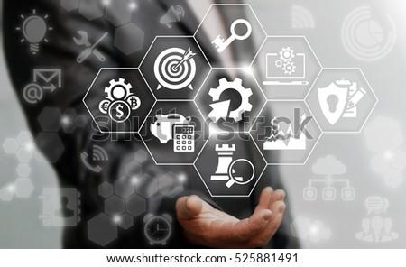 Man offers automation modernization integration business concept. Gear cogwheel arrow industrial sign. Integrated tech upgrade smart device service network, communication cloud safety technology.