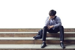 Man office worker sitting on stair and stressed from layoff during the crisis