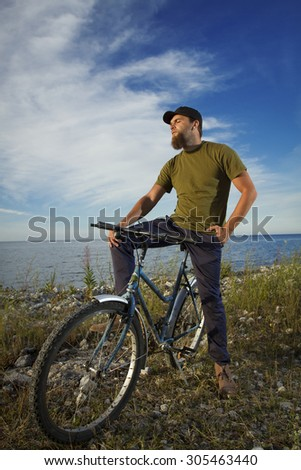 man on a bicycle near the sea. Travel and Recreation summer