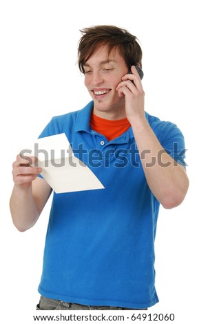 Man on a cell phone reading a gift card