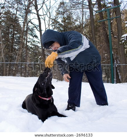 Man on a cold winter day with his pet
