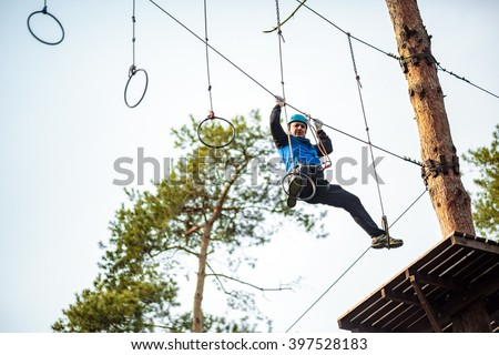 Man on a difficult course in an adventure park