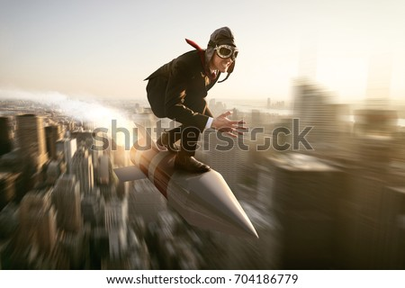 Man on a rocket above new york city