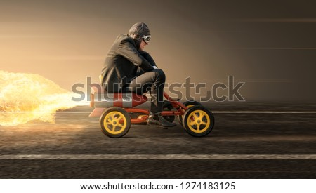 Man on a rocket pedal car