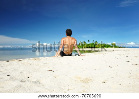 Man on a tropical beach