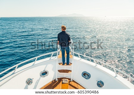 Man on a yacht. Beautiful view from a bow of a yacht at seaward. Sailing. Luxury yachts. Boats in a sailing regatta. Summer vacation and voyage concept