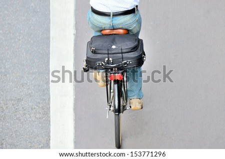 Man on bicycle on his way home from work, in bike lane