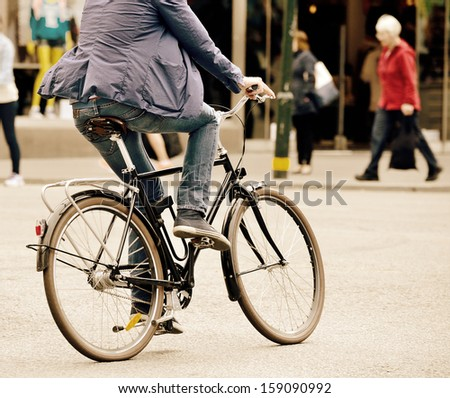 Man on bike in traffic