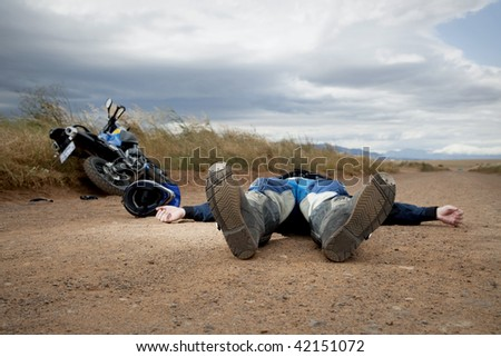 Man on ground after a motorcycle accident