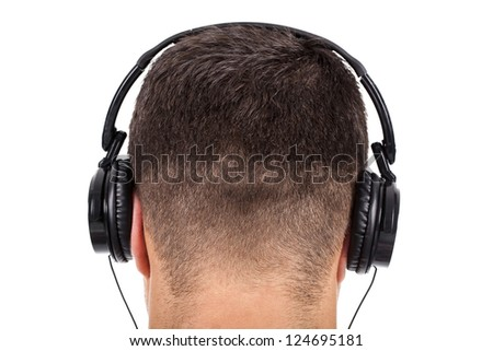 man on his back with headphones on head