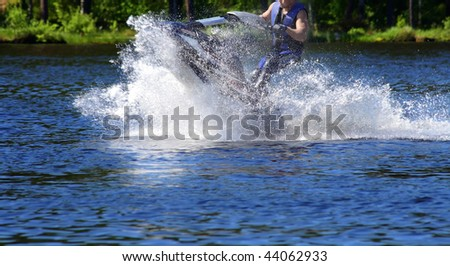 Man on jet ski - stock photo