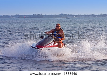 Man on jet ski in motion