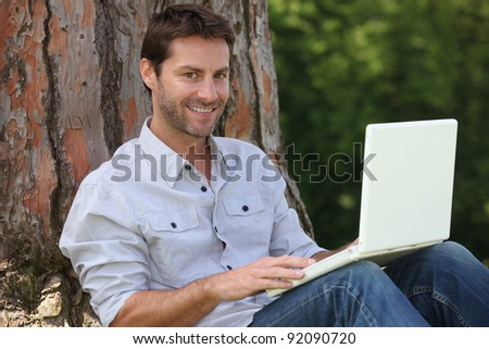 Man on laptop outside