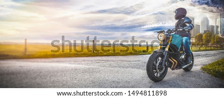 man on motorbike on the road. having fun driving the empty road on a motorcycle tour journey. copyspace for your individual text.