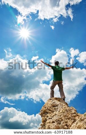 Man on peak of mountain. Conceptual design.