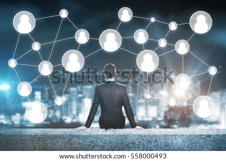 Man on rooftop looking at people icons. Human resources concept #558000493