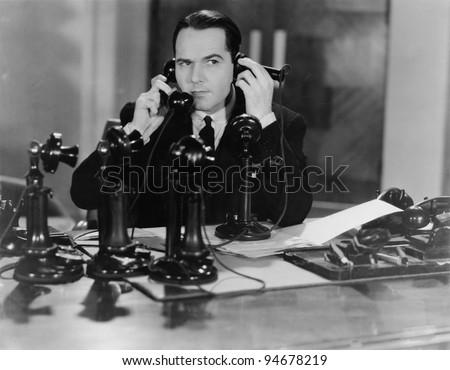 MAN ON SEVERAL PHONES