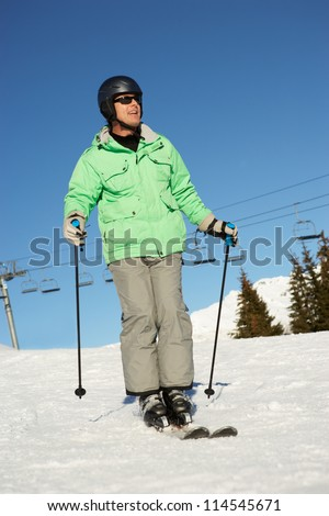 Man On Ski Holiday In Mountains