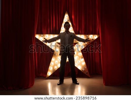 Man on stage with star on background #235898716
