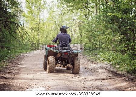 Man on the ATV Quad Bike on the mountains road.  Stock photo ©