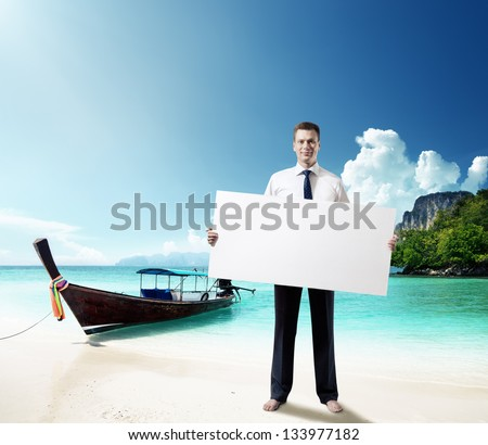 man on the beach of Thailand with empty board in hand