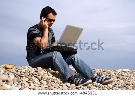 man on the beach with laptop