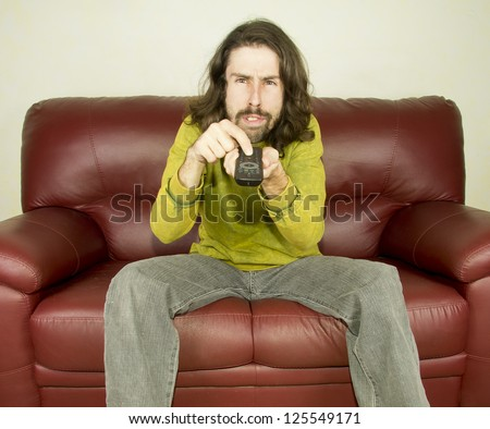 man on the couch remote control