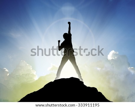 Man on the peak of mountain and sunlight  , success winner business concept #333911195