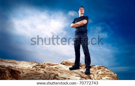 Man on the top of mountain. - stock photo