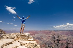 Man on the top of the Grand Canyon
