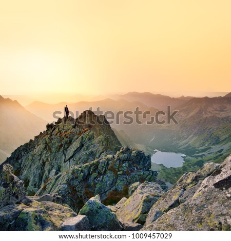 Man on the top of the hill in mountains. Photo with edit space. High Tatras, Slovakia
