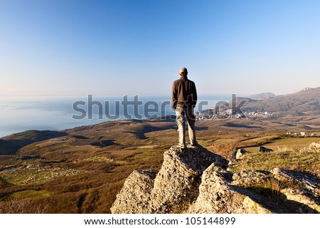 Man on the top of the mountain
