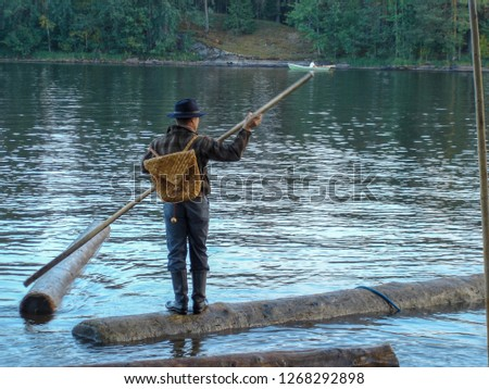Man on the water sailing with a tree like old times #1268292898