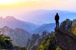Man on top of mountain,conceptual scene