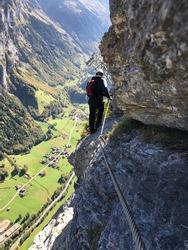 Man on Via Ferrata in Murren Switzerland.