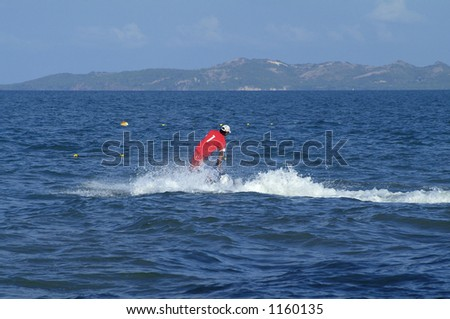 Man on water-scooter seen from behind