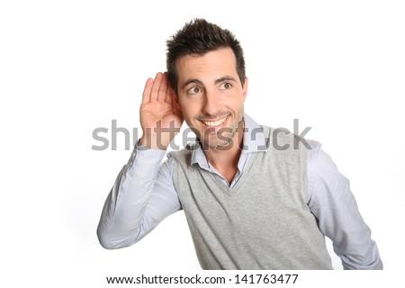 Man on white background listening carefully