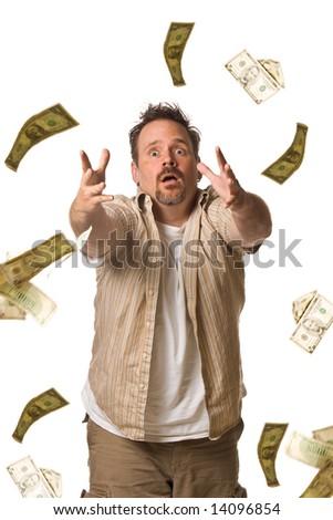 Man on white chasing falling money