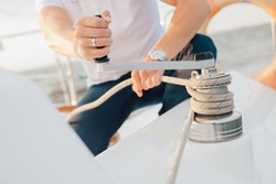 Man on yacht holding rope