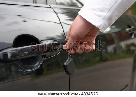 man open car door by key