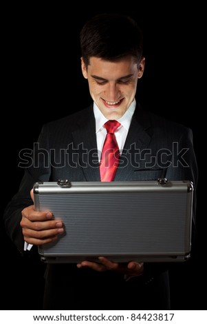 man open metal suitcase