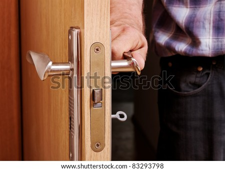 Man open the door, horizontal photo.