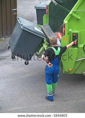 Man operates rubbish collecting machine, close-up