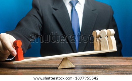 Man opposes red man to group of people on scales. Give a head start. Get an edge advantage. Career growth, nepotism. Leader and valued employee. Inequality of rights. Social significance. Stock photo ©