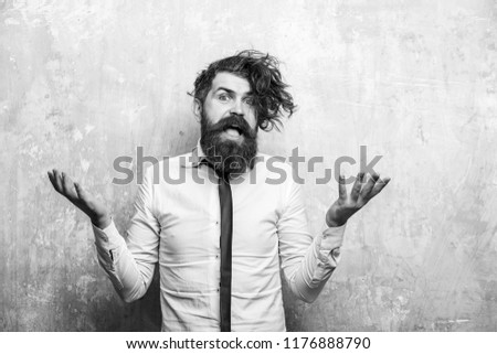 man or hipster with long beard and stylish hair on surprised happy face in tie and white shirt on textured beige background #1176888790