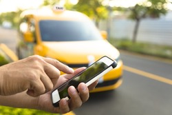 Man orders a taxi from his cell phone