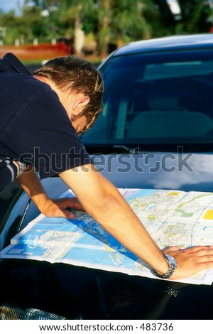 Man outside looking at a map