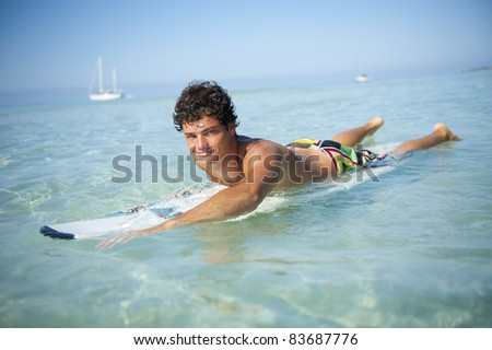 Man over surf board swimming