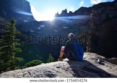 Man Overlooking the Edge of the Trail at Estes Park Stock photo ©
